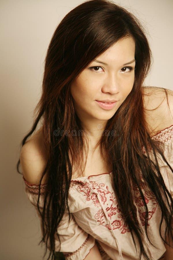 亚洲美好女孩微笑 免版税库存照片
