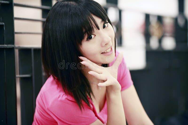 亚洲逗人喜爱的女孩微笑 图库摄影