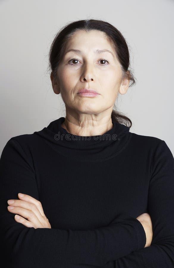 亚裔严重的妇女 免版税库存照片
