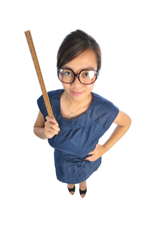 亚裔中国看起来的严厉的教师 库存照片