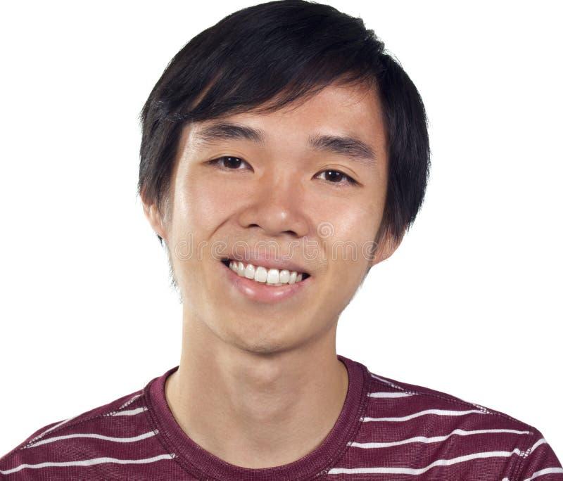 亚裔人微笑的年轻人 库存照片