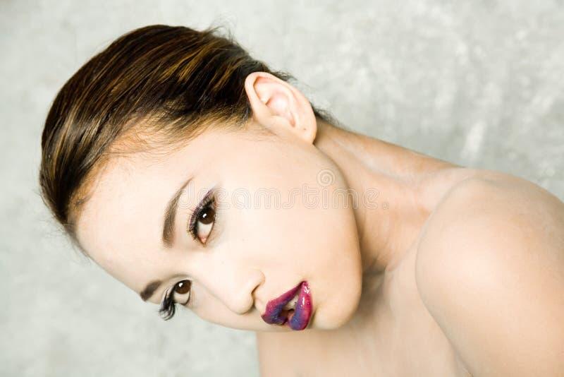 亚裔俏丽的妇女 免版税库存图片