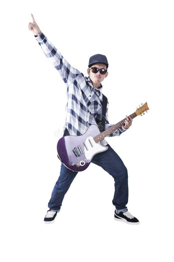 亚裔冷静吉他人他的作用 免版税库存照片