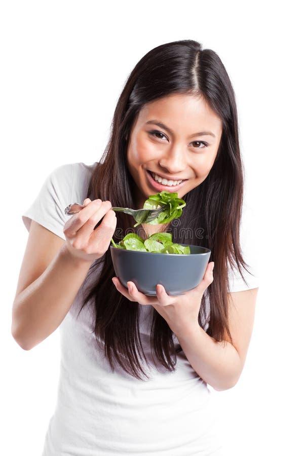 亚裔吃的沙拉妇女 免版税库存图片