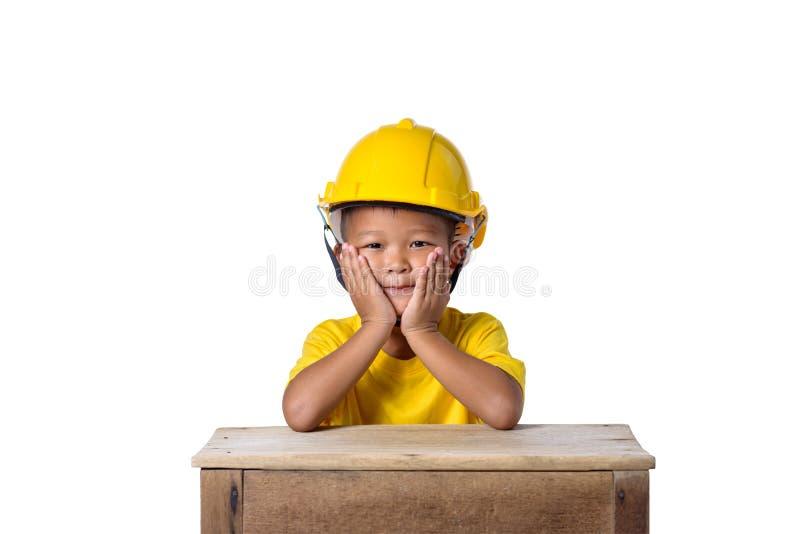 亚裔在whi隔绝的孩子头戴安全帽的和微笑 免版税库存图片