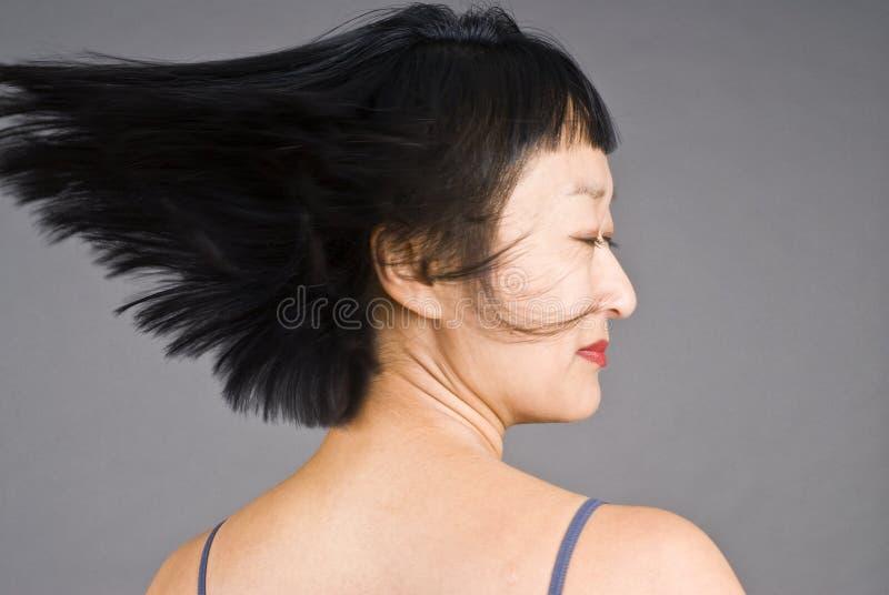 亚裔头发短小妇女 免版税库存照片
