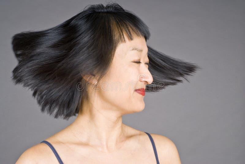 亚裔头发短小妇女 免版税库存图片