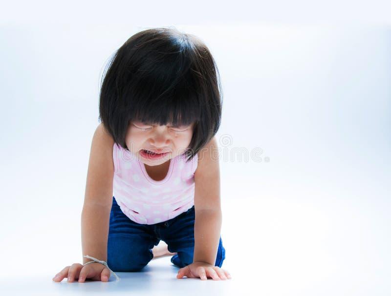 亚裔女孩哭泣的孤立 库存照片
