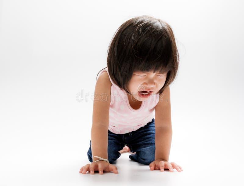 亚裔女孩哭泣的孤立 库存图片