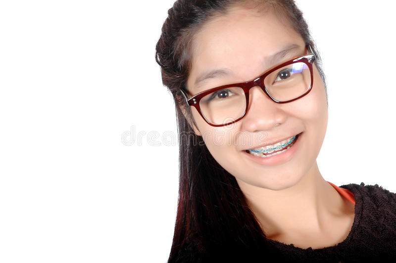 亚裔女孩画象有玻璃和括号的 库存照片