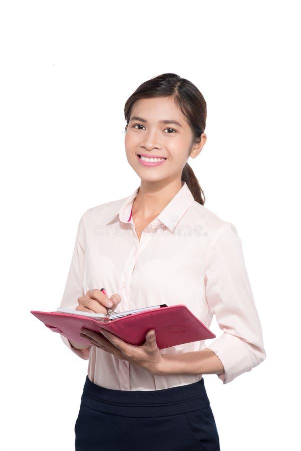 亚裔女实业家注意关于笔记本的 库存图片