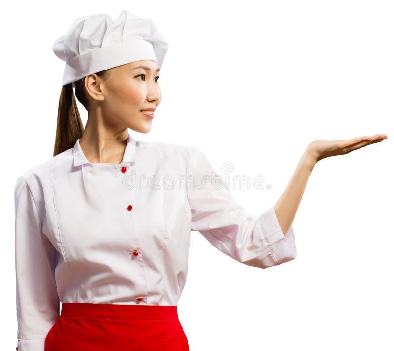 亚裔女性主厨显示他的现有量 免版税图库摄影