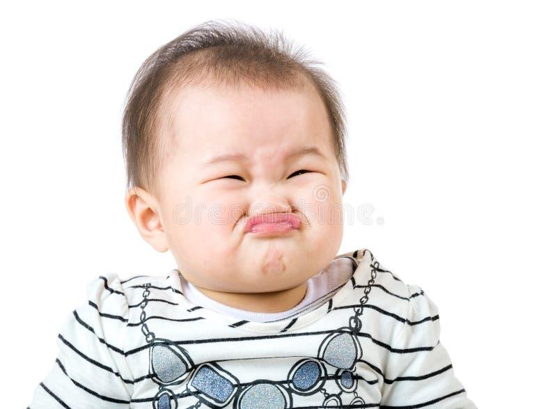 亚裔女婴做生气面孔 图库摄影