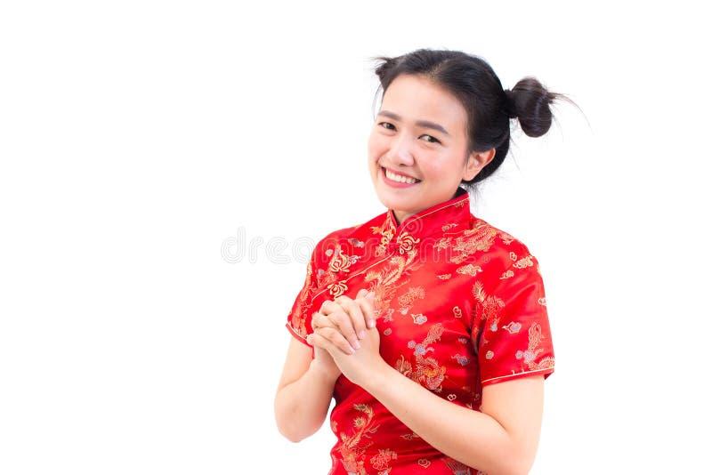亚裔妇女佩带的汉语穿戴与cong姿态的cheongsam  库存图片