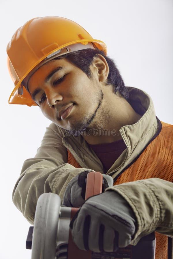 亚裔安全帽工作者 库存照片