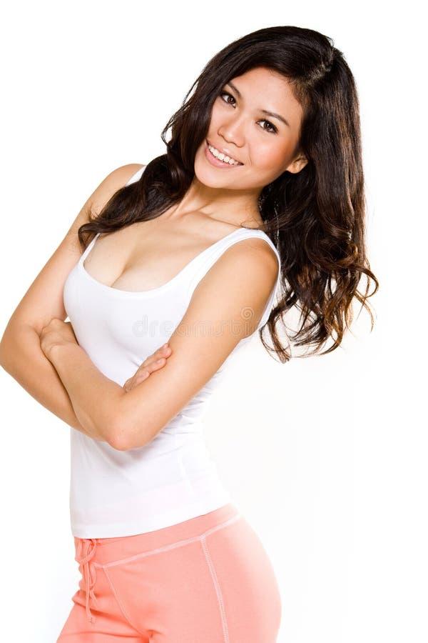 亚裔愉快的微笑妇女 免版税库存照片