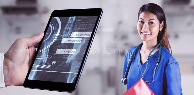 亚裔护士的综合图象有看照相机的听诊器的 库存照片