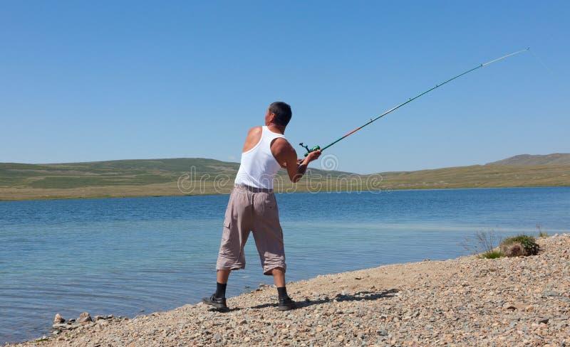 亚裔渔夫 免版税图库摄影