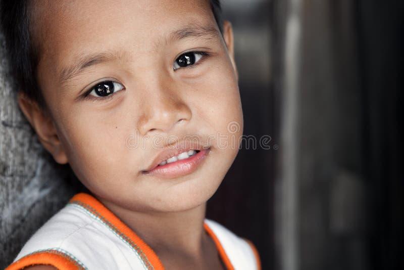 亚裔男孩贫困纵向年轻人 免版税库存照片