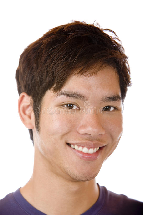 亚裔确信的愉快的微笑的学员 免版税库存照片