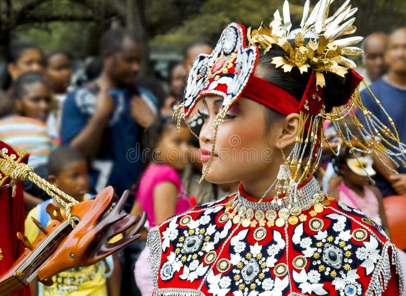亚裔美丽的礼服国民妇女 免版税库存照片