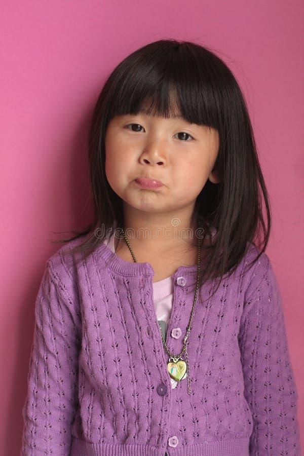 亚裔表面女孩哀伤的一点 免版税库存图片
