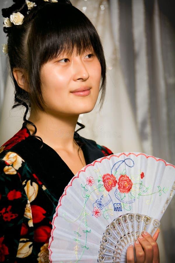 亚裔逗人喜爱的风扇女孩 免版税库存图片
