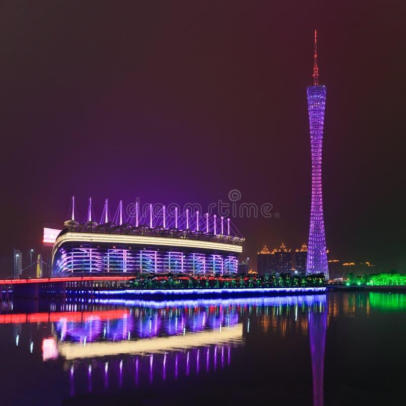 亚运会体育场高广州塔在晚上,广州,中国 免版税图库摄影