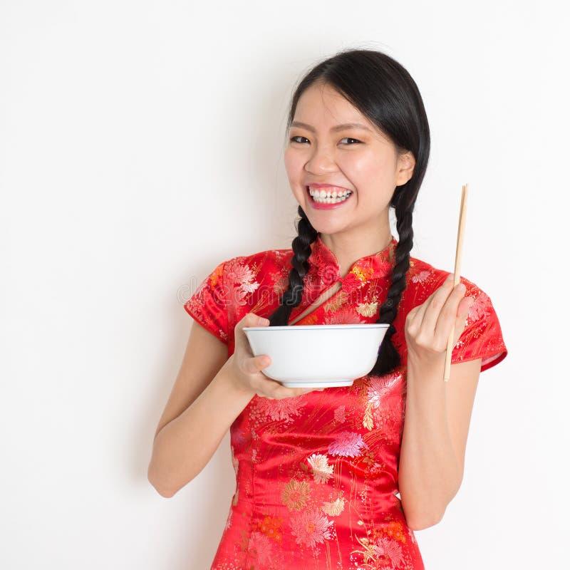 亚洲中国女孩吃 免版税图库摄影