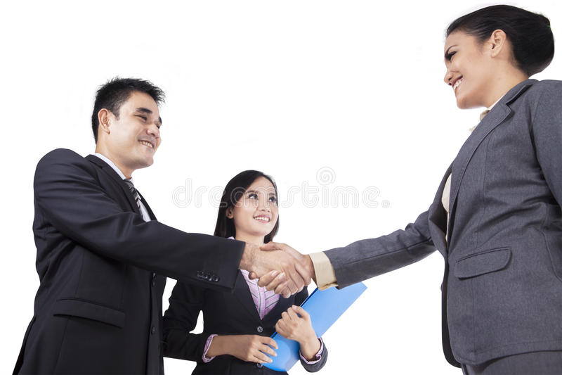 亚洲买卖人握手 库存图片
