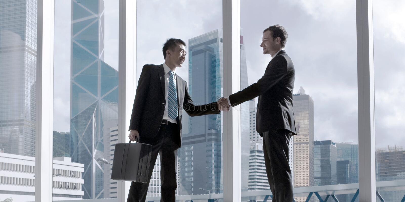 亚洲企业握手协议合作概念 库存图片