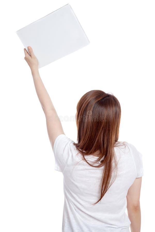 亚洲女孩举行空白标志 库存图片