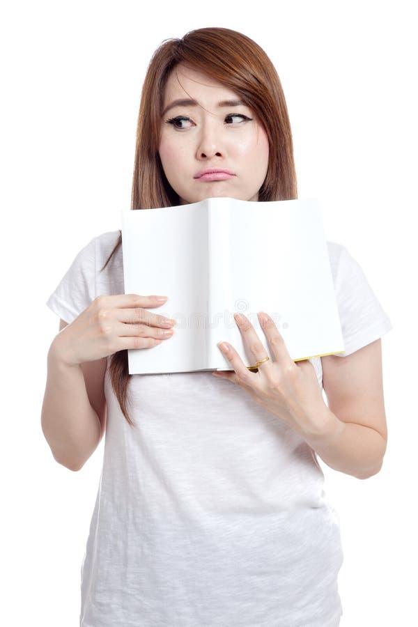 亚洲女孩打扰阅读书 库存照片
