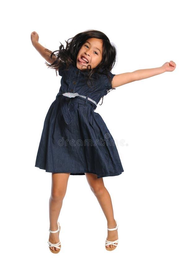 亚洲女孩跳跃 免版税库存图片