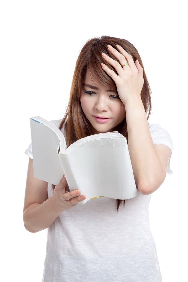 亚洲女孩头疼不了解书 库存图片
