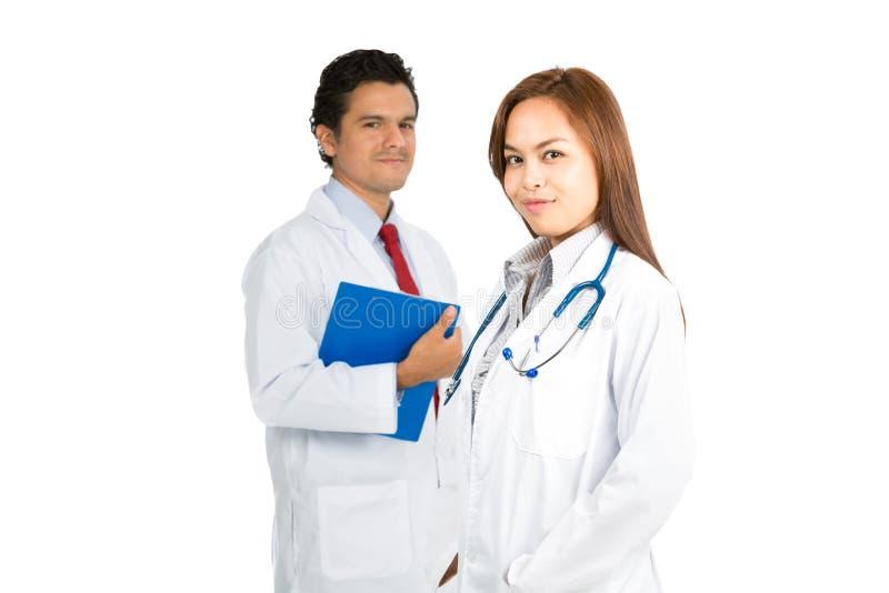 亚洲女性西班牙男性医治队微笑的H 库存图片
