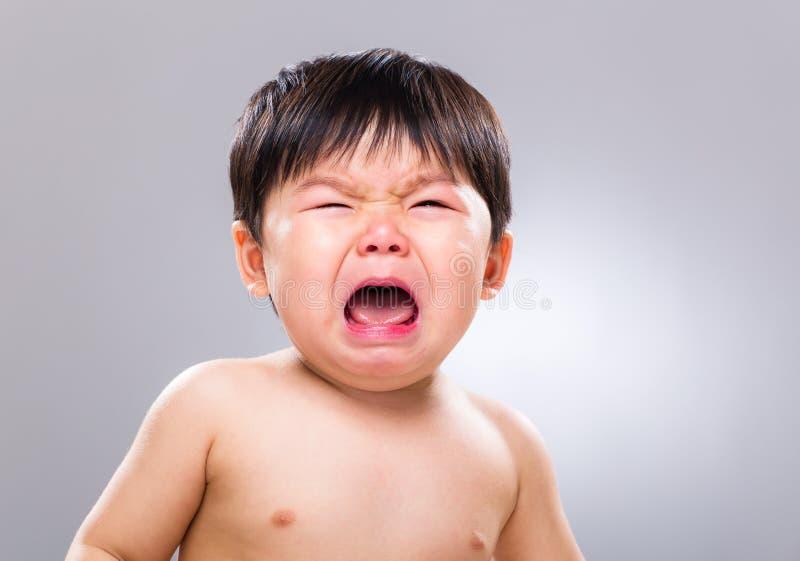 亚洲婴孩哭泣 免版税图库摄影