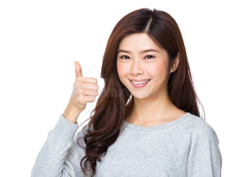 亚洲显示的赞许妇女年轻人 免版税库存图片