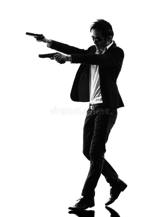 亚洲枪手凶手剪影 库存图片