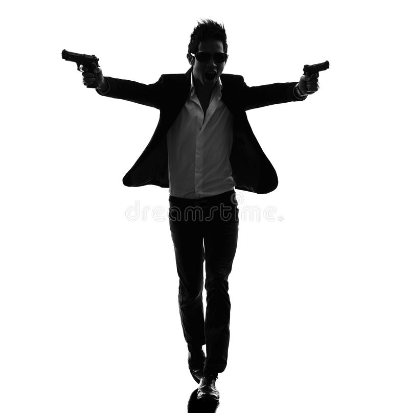 亚洲枪手凶手剪影 免版税库存图片