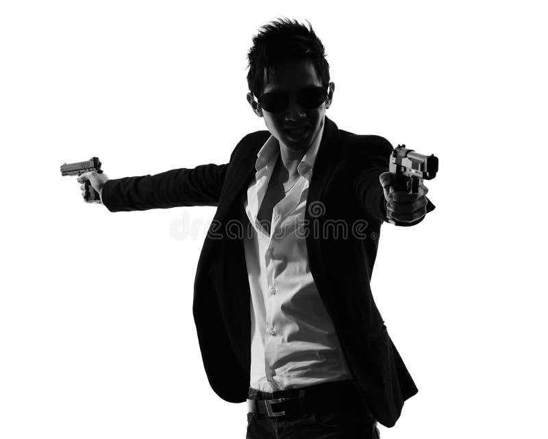 亚洲枪手凶手剪影 图库摄影