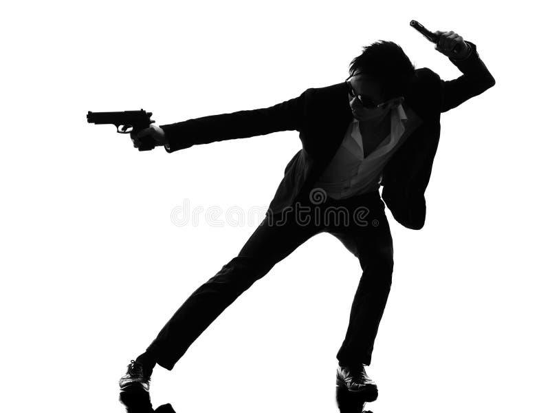 亚洲枪手凶手剪影 免版税图库摄影