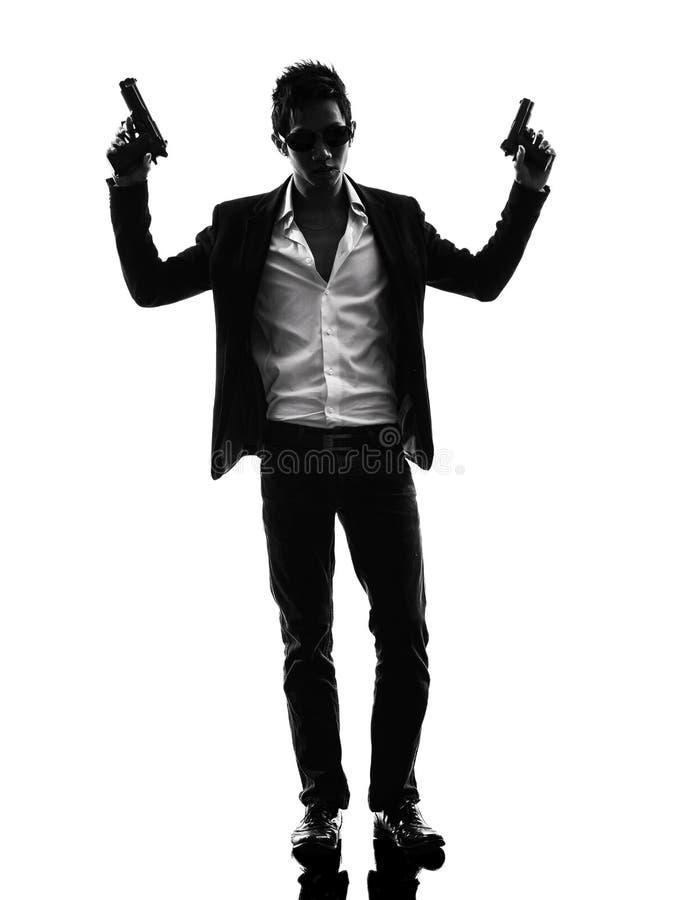 亚洲枪手凶手身分剪影 图库摄影