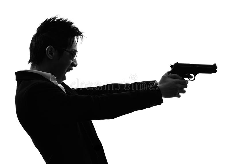 亚洲枪手凶手画象射击剪影 库存图片