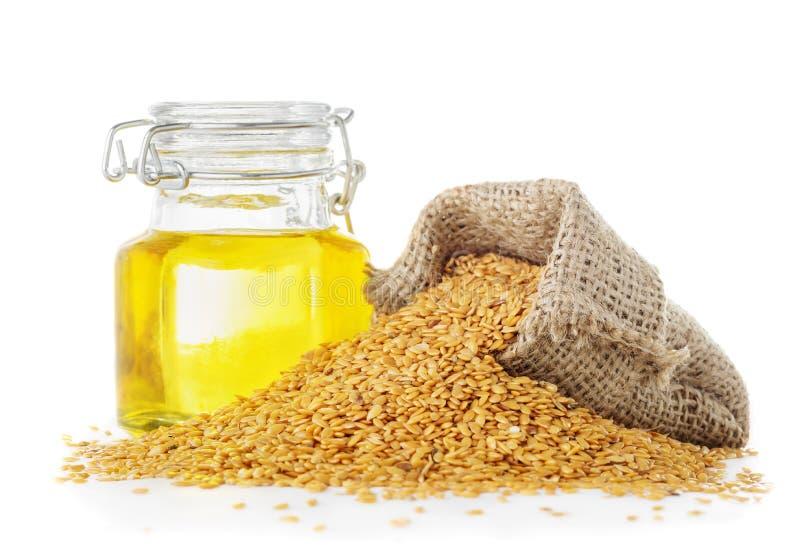 亚麻仁油和金黄亚麻籽 免版税库存照片