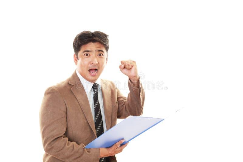 亚洲生意人微笑 免版税库存图片