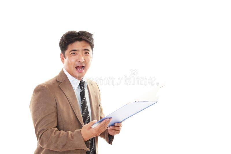 亚洲生意人微笑 免版税库存照片