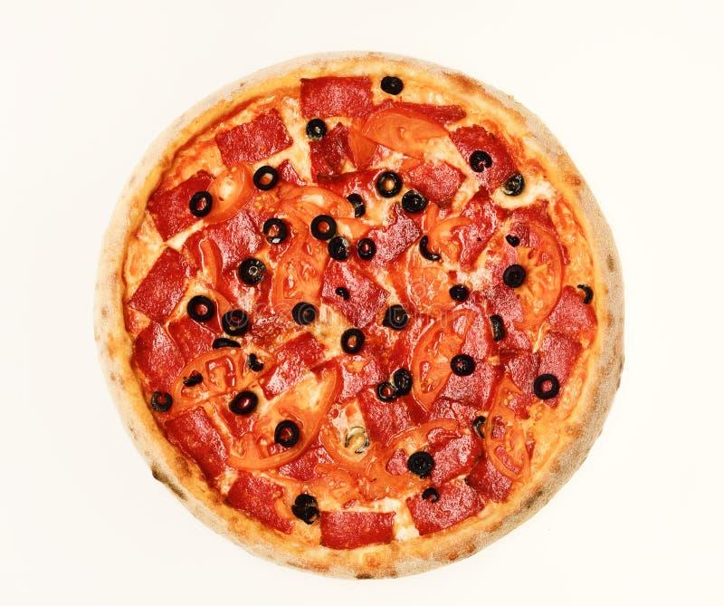 交付和意大利烹调概念 薄饼用意大利辣味香肠和蕃茄 库存图片