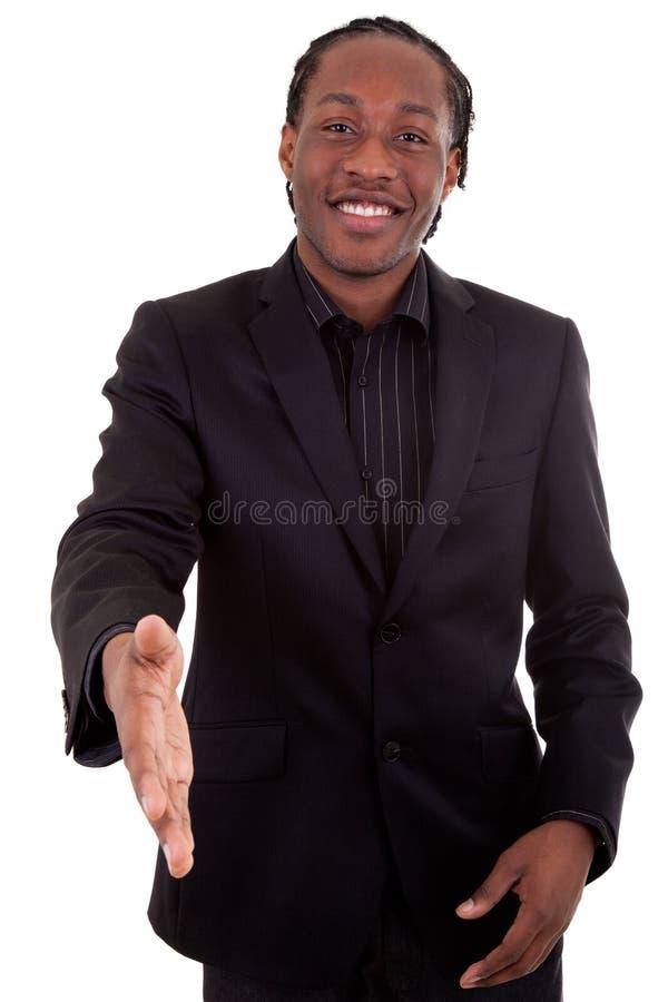 产生现有量的黑色生意人 库存图片