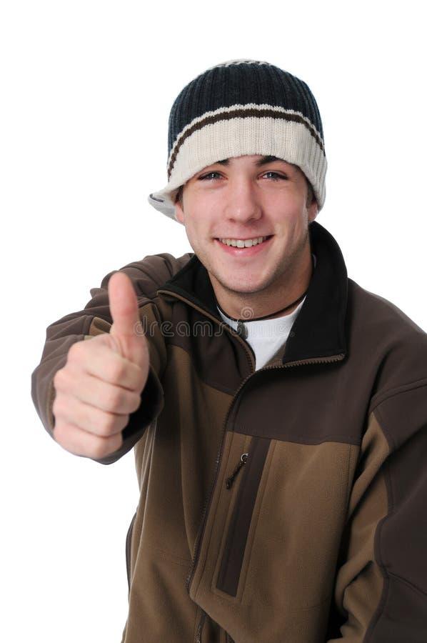 产生符号青少年的赞许的男孩 库存照片